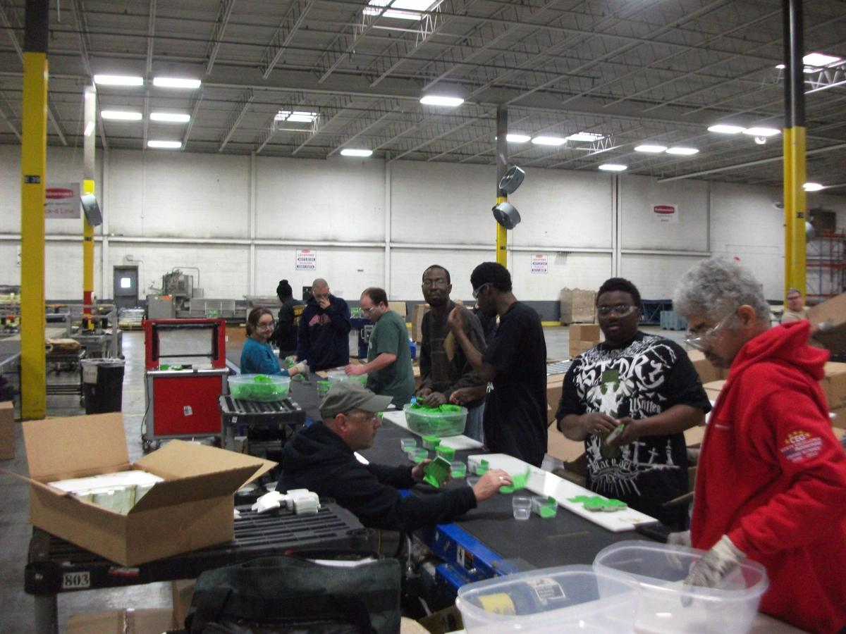 Picture of individuals working at Rubbermaid in 2014.